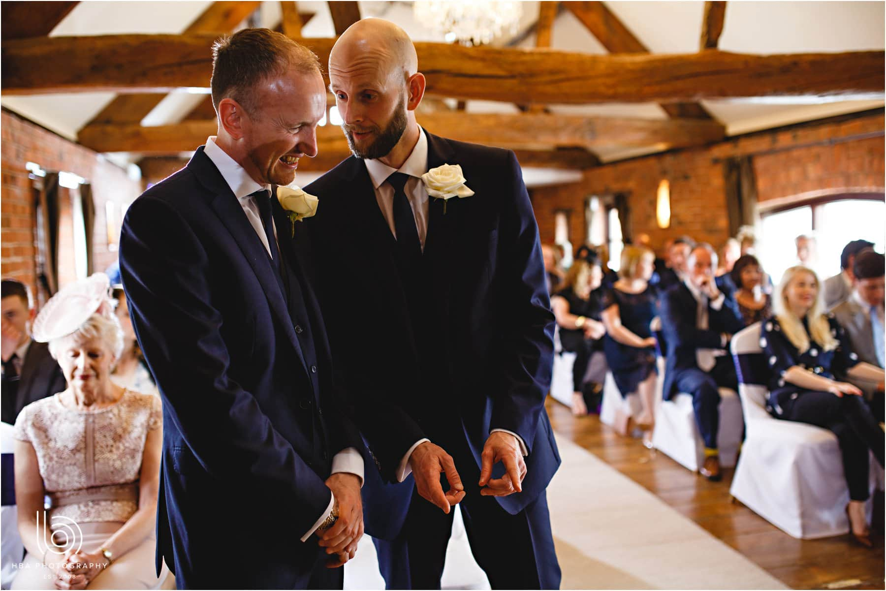 the groom and best man waiting for the bride at Swancar Farm
