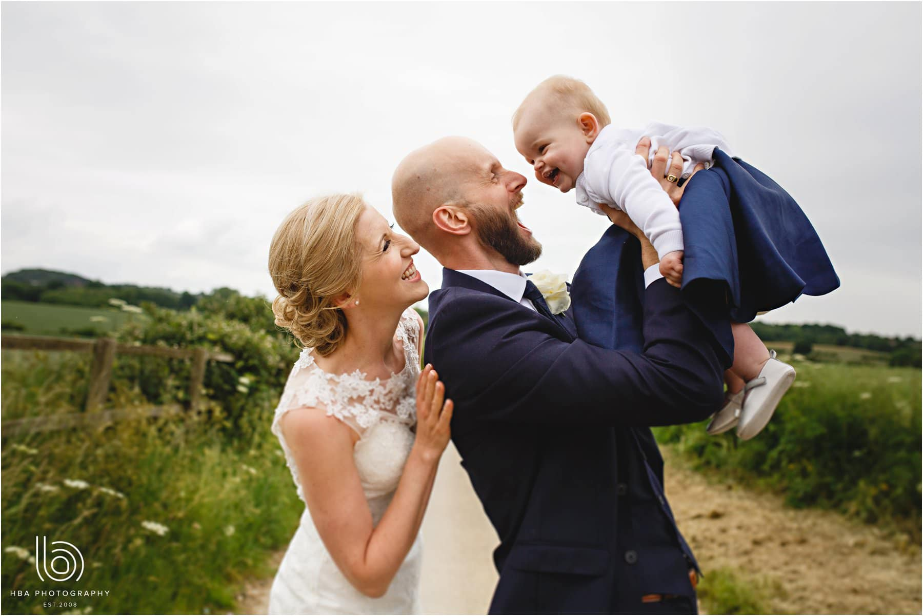 the bride & groom and their daughter