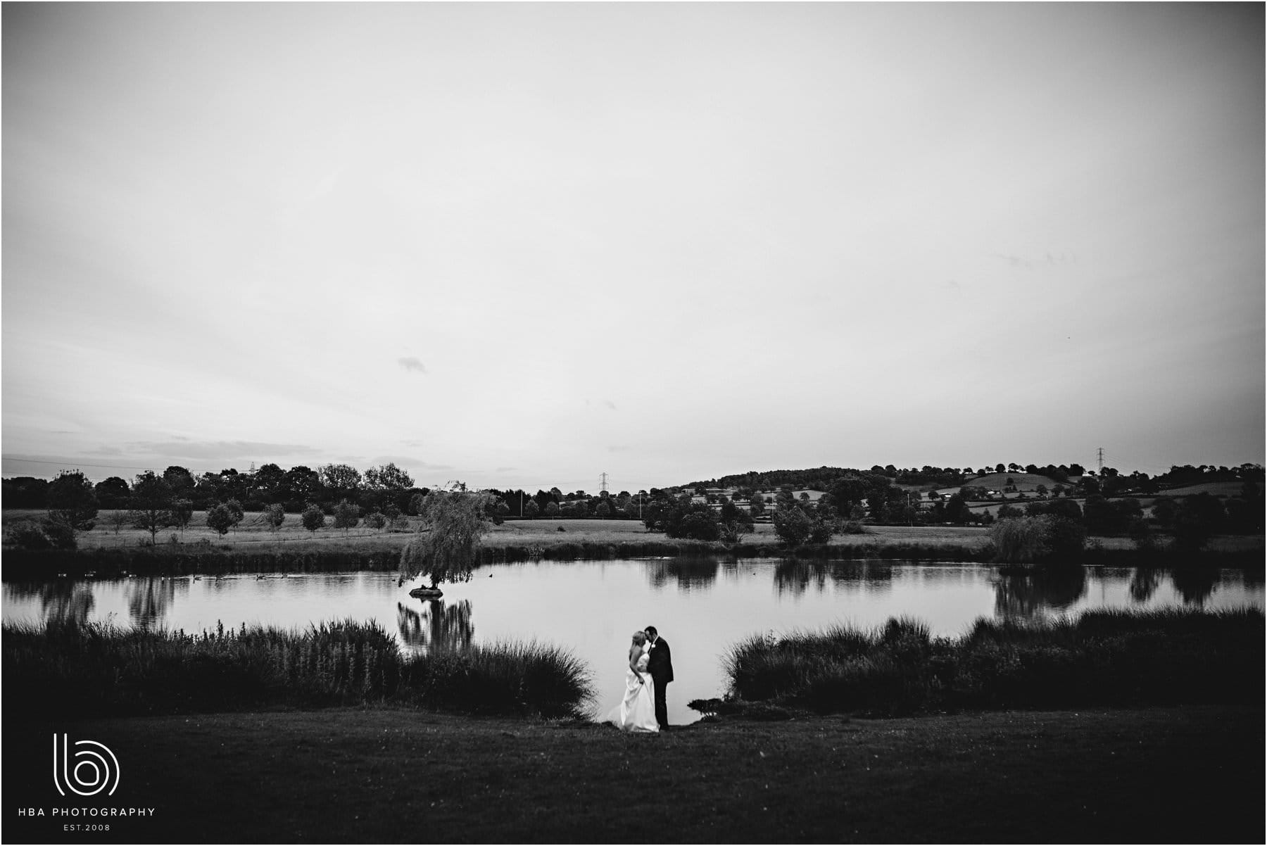 the bride & groom down by the lake