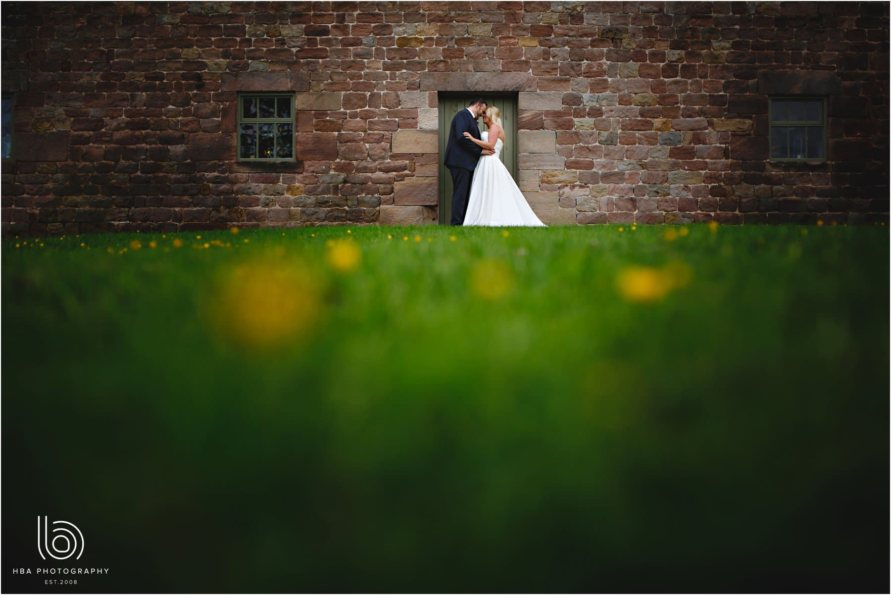 the bride & groom in the buttercups