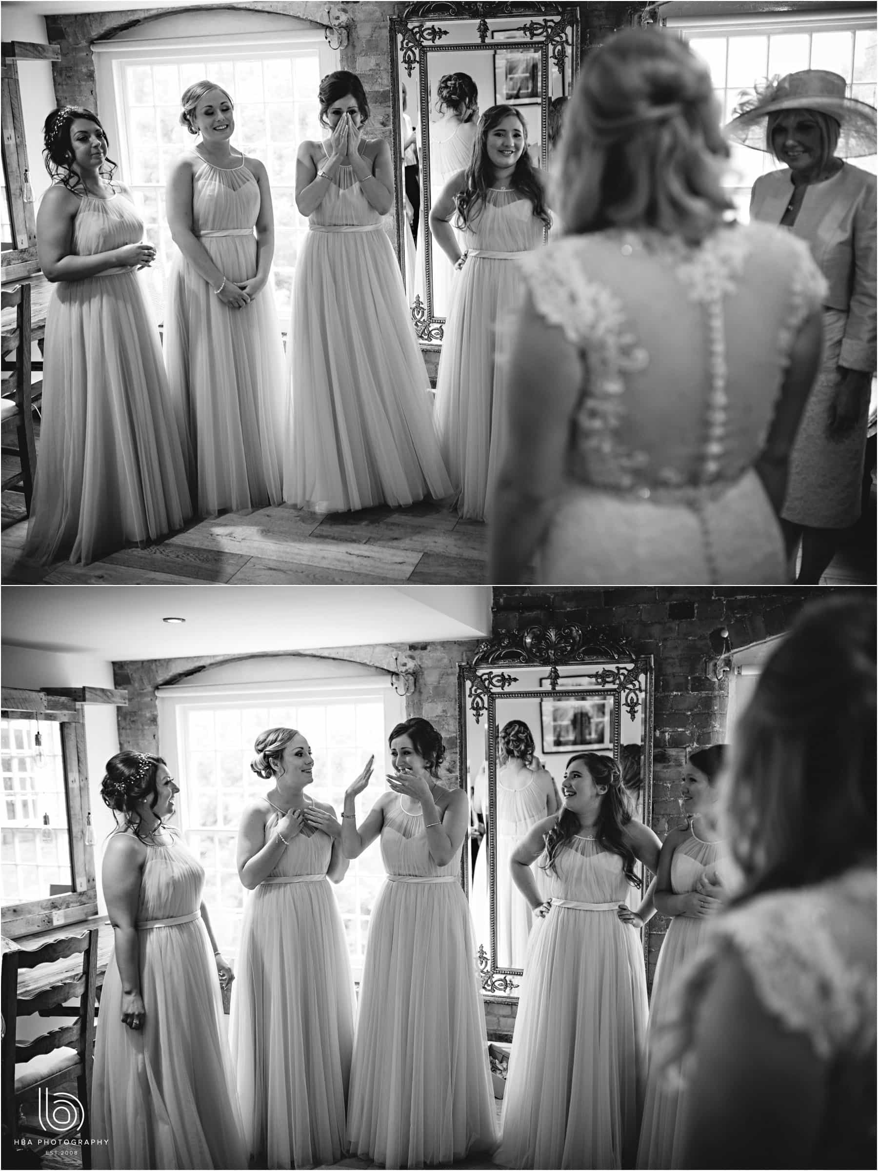 the bridesmaids seeing the bride for the first time