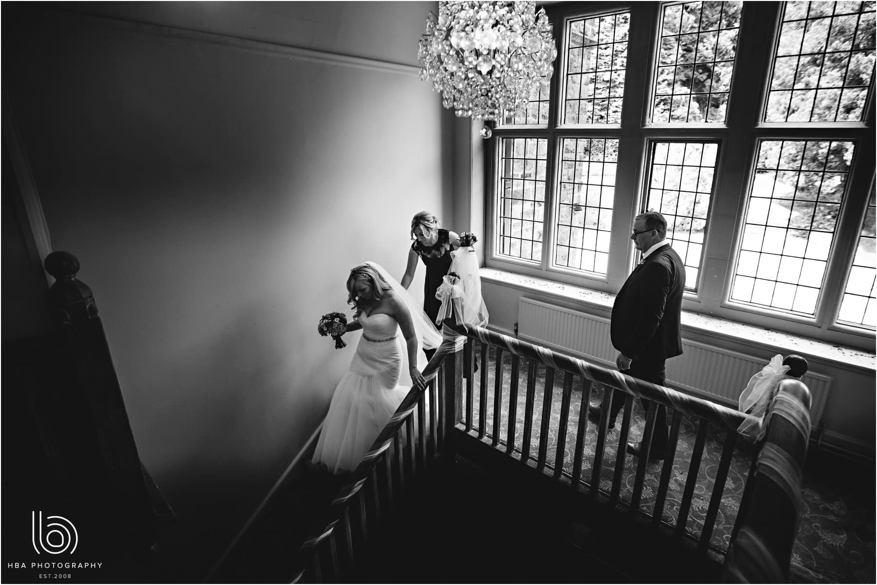 the bride walking down the stairs