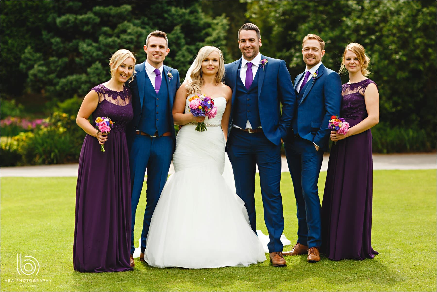 The bride & groom with their wedding party