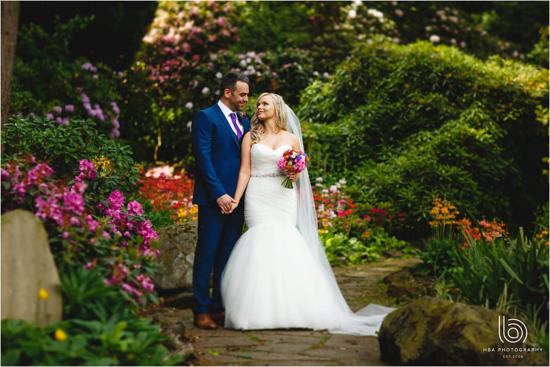 The bride & groom in the gardens