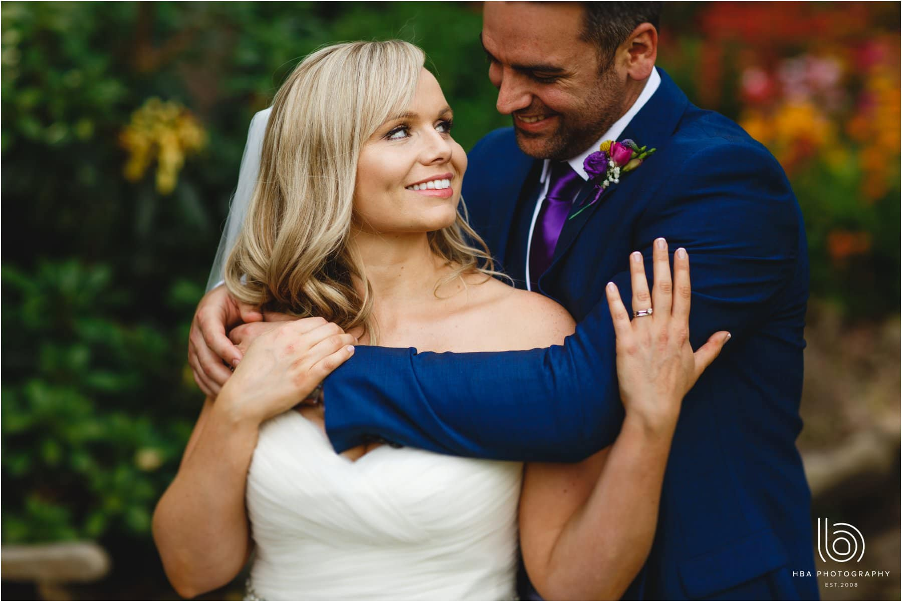 The bride & groom cuddling