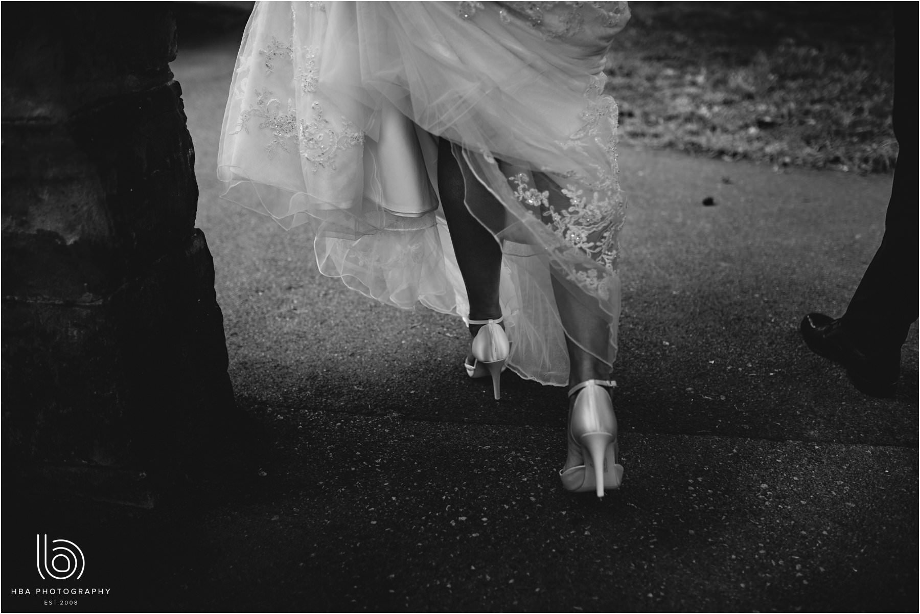 the bride's shoes as she walks along