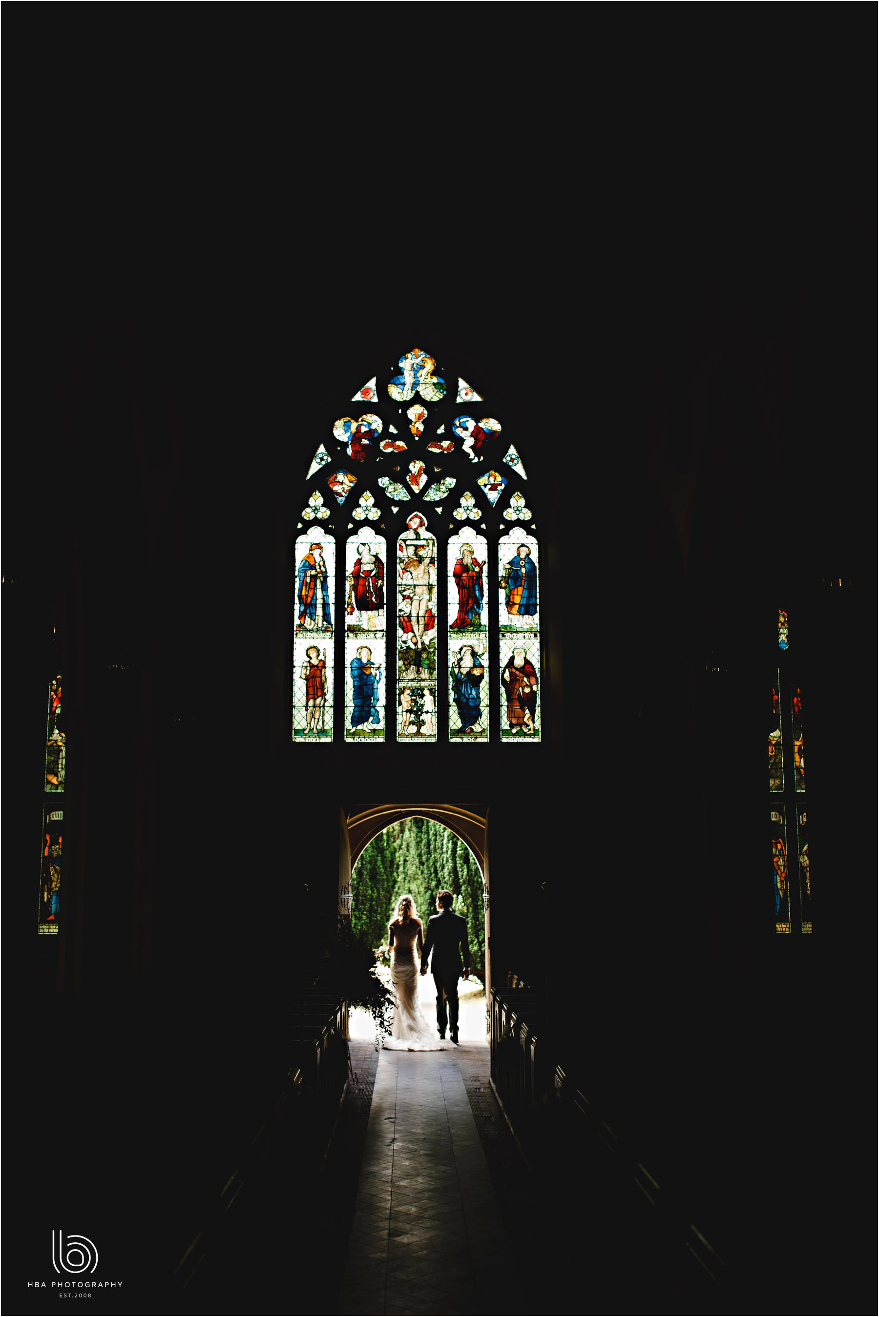 the bride & groom in silhouette att he church door
