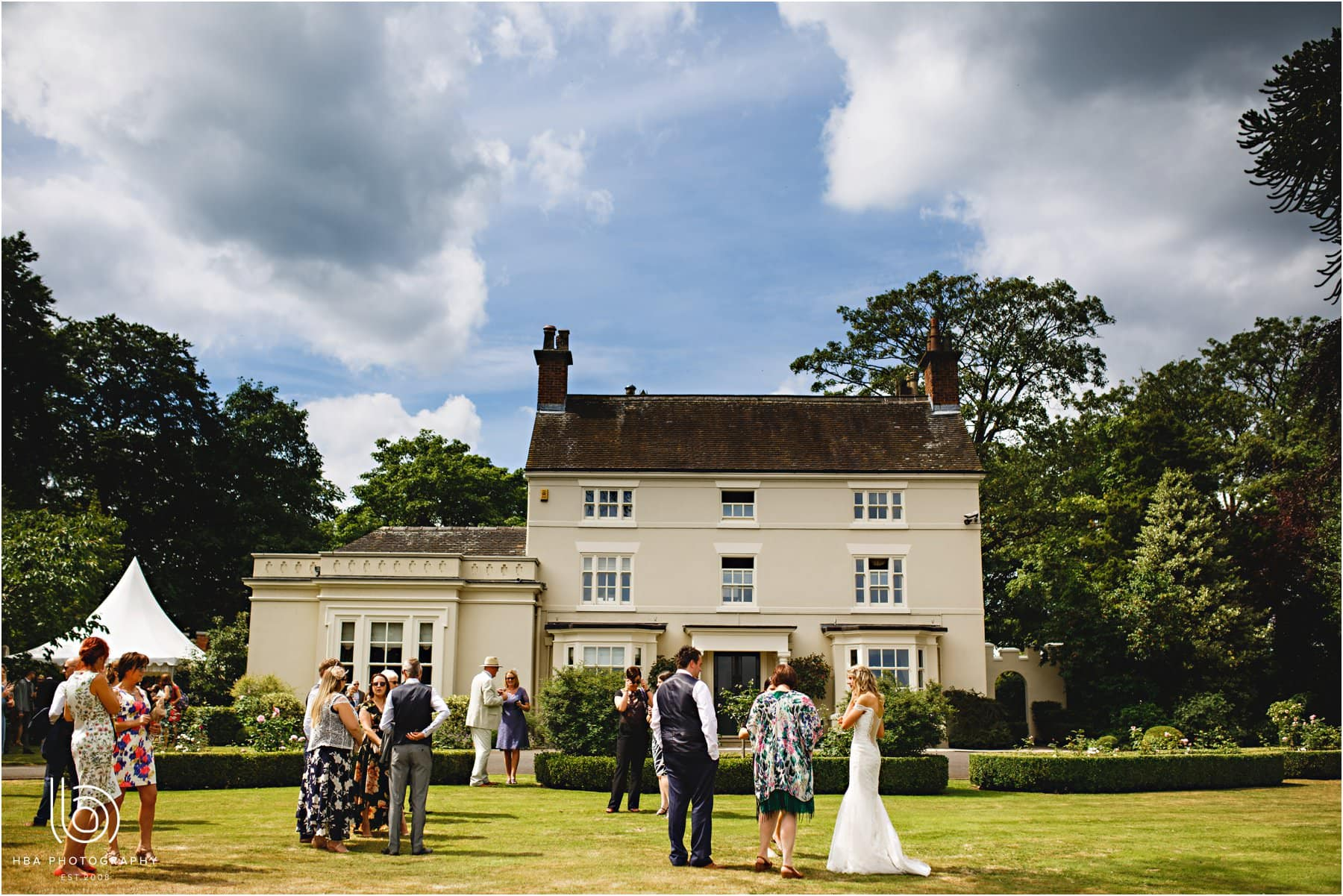 wedding guests outside the manor house