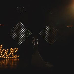 The bride and groom stood in darkness at Shustoke farm barns