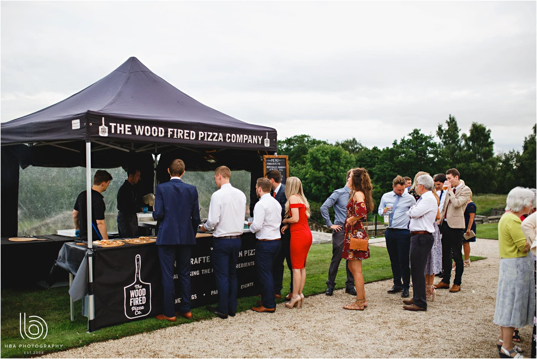 Wedding Guests Playing Lawn Pizza For Evening Food