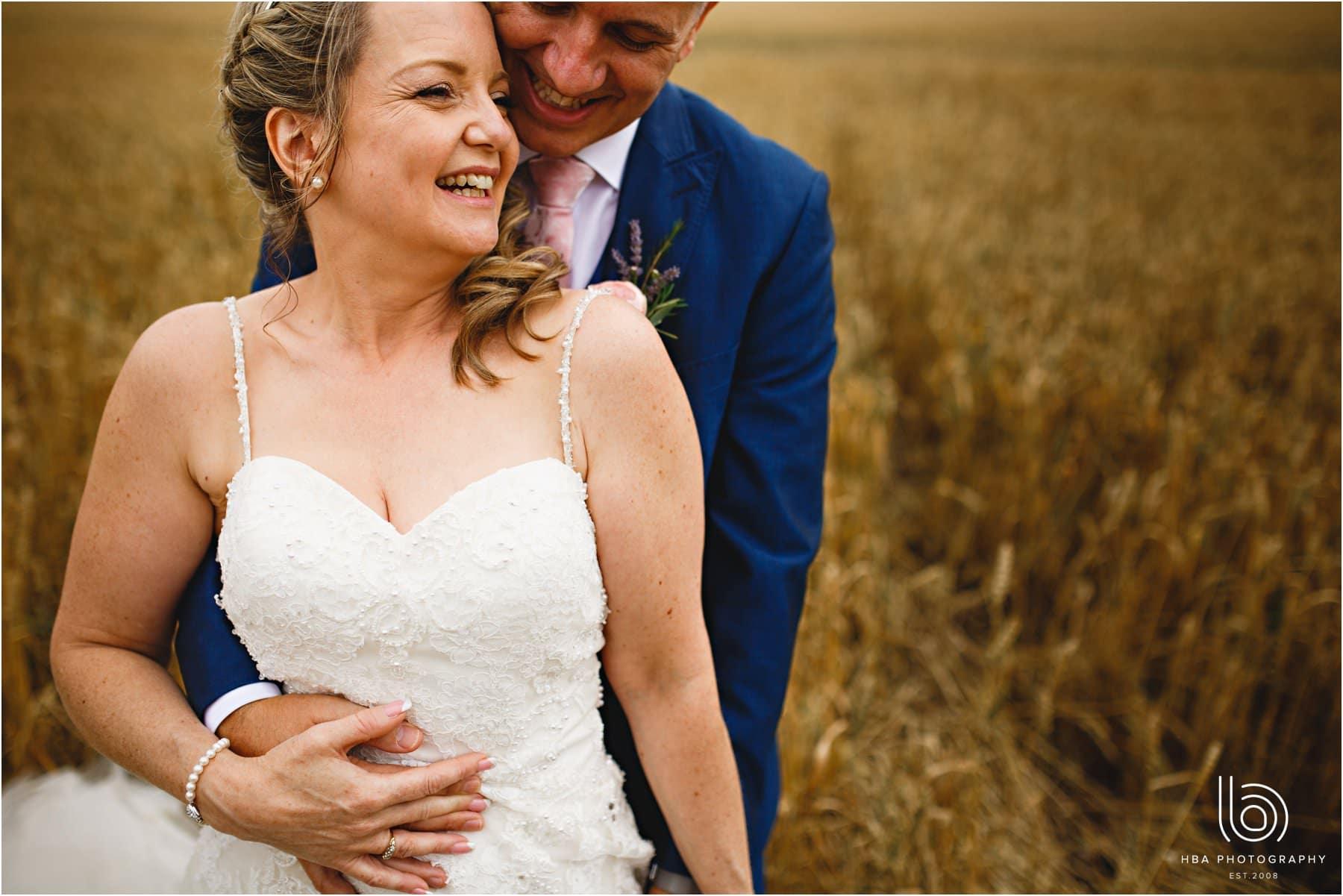 the bride & groom in the corn field