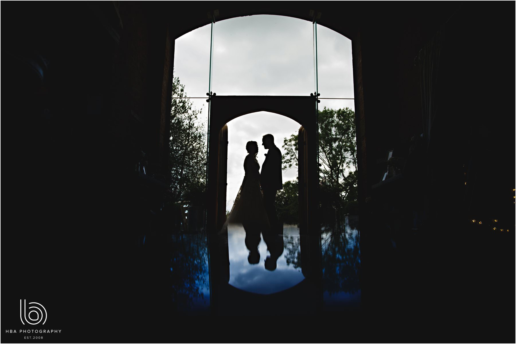 the bride & groom in silhouette and reflection