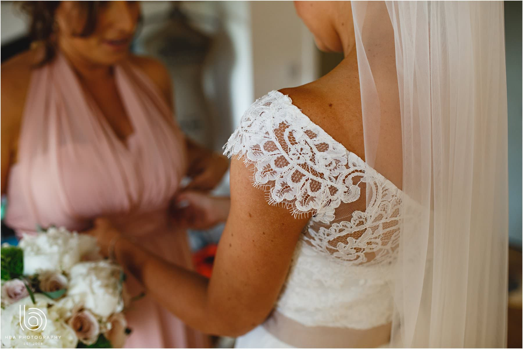 the detail on the brides dress