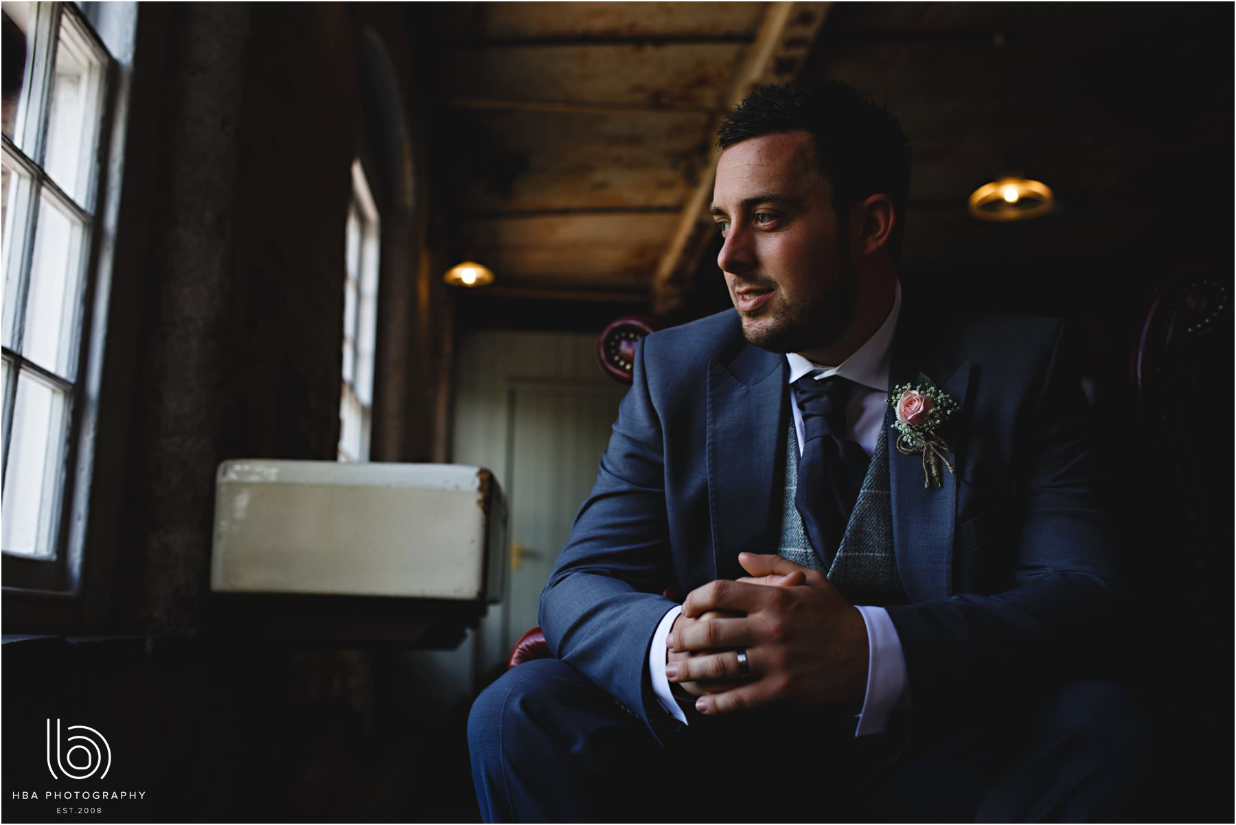 a portrait of the groom at The West Mill