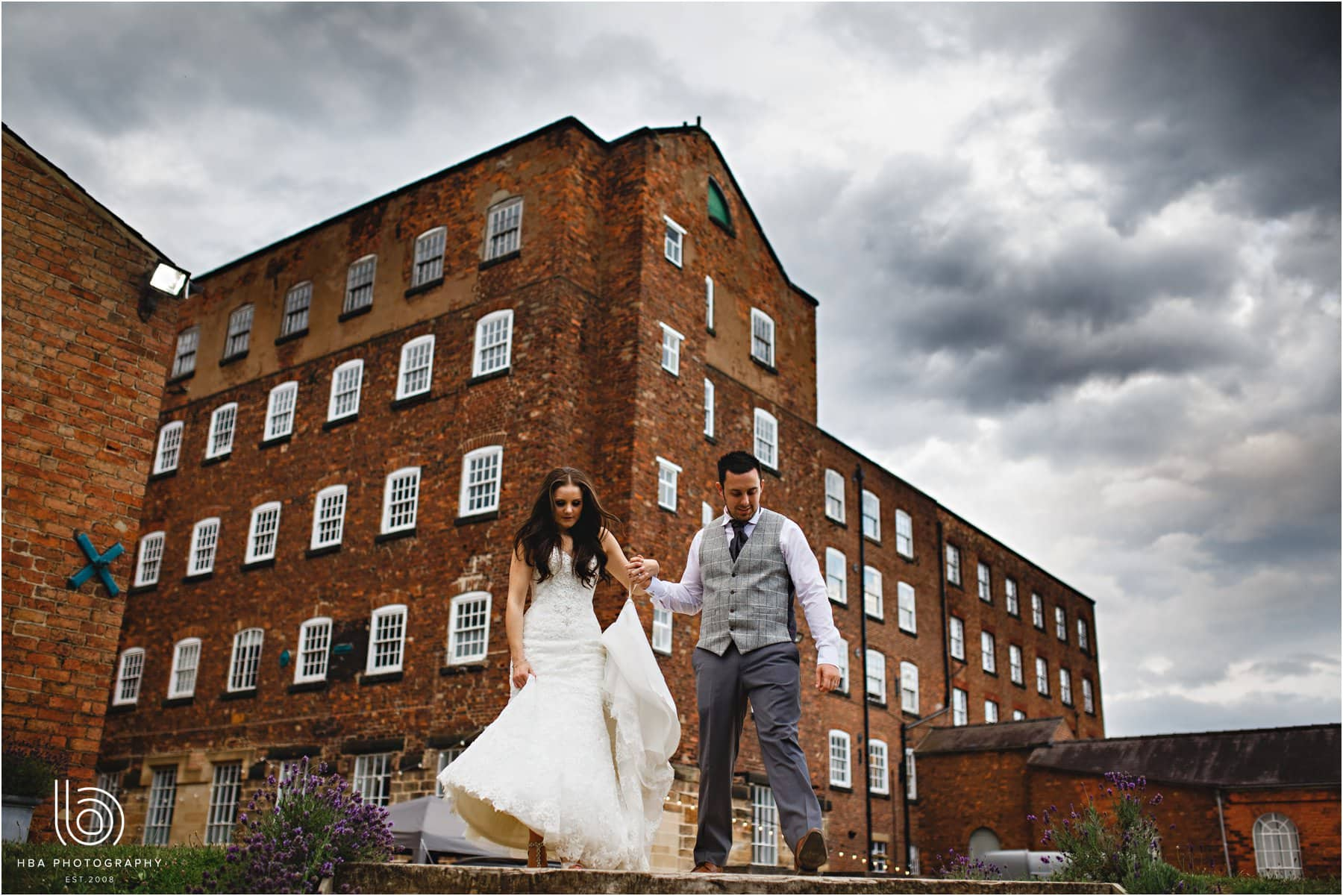 the bride & groom walking down the steps