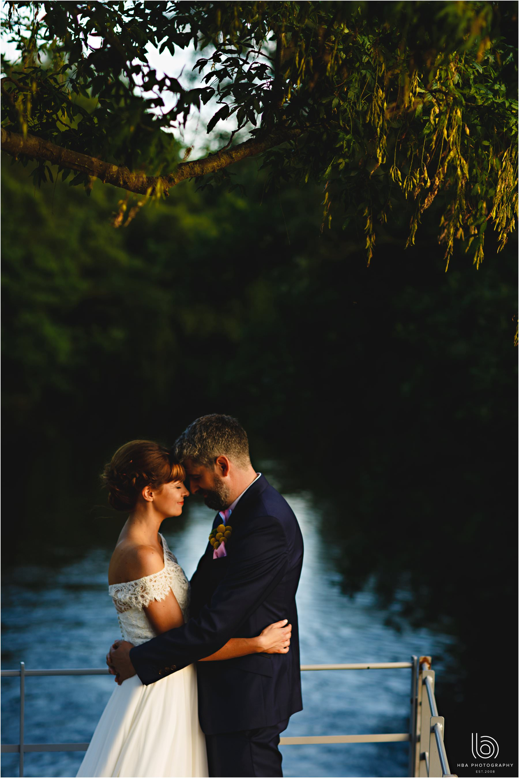 the bride and groom by the river