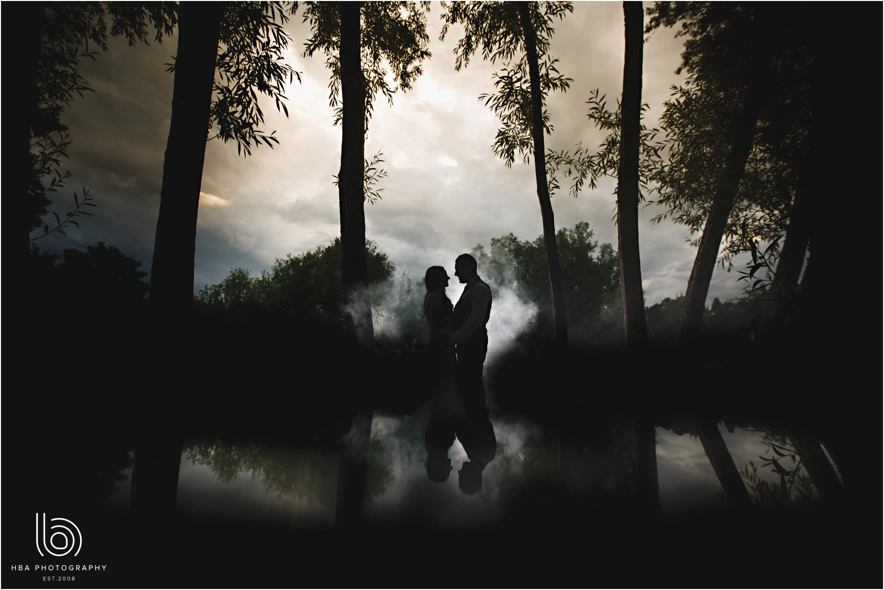 the bride & groom in the mist
