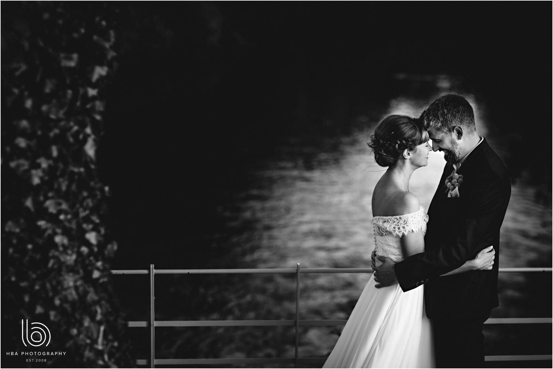 The bride & groom together by the river
