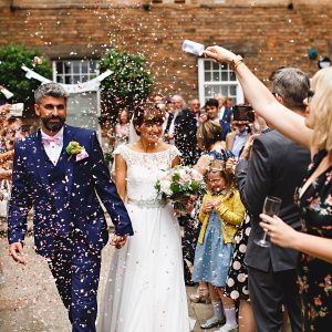 lots of confetti and the west mill in derbyshire on fran and gavins wedding day