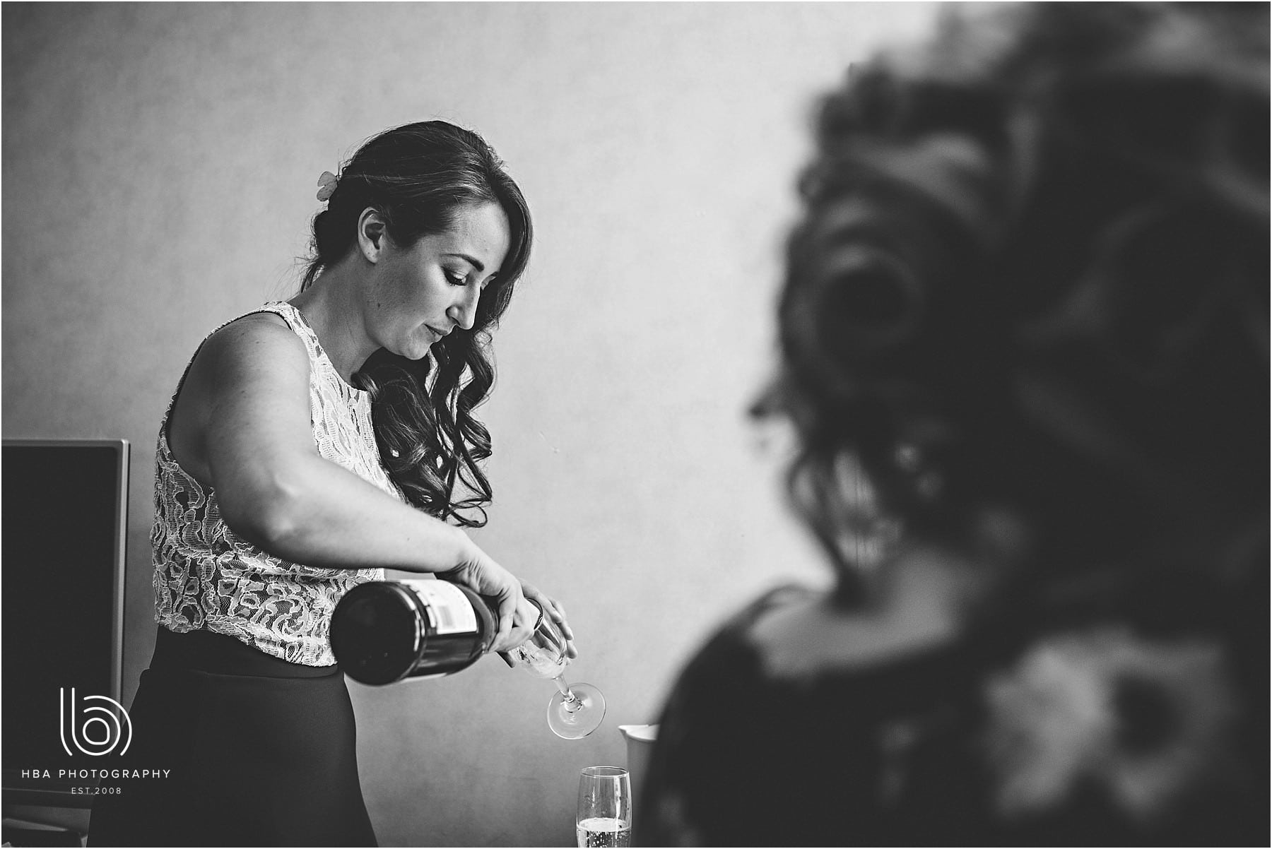 the bridesmaid pouring prosecco