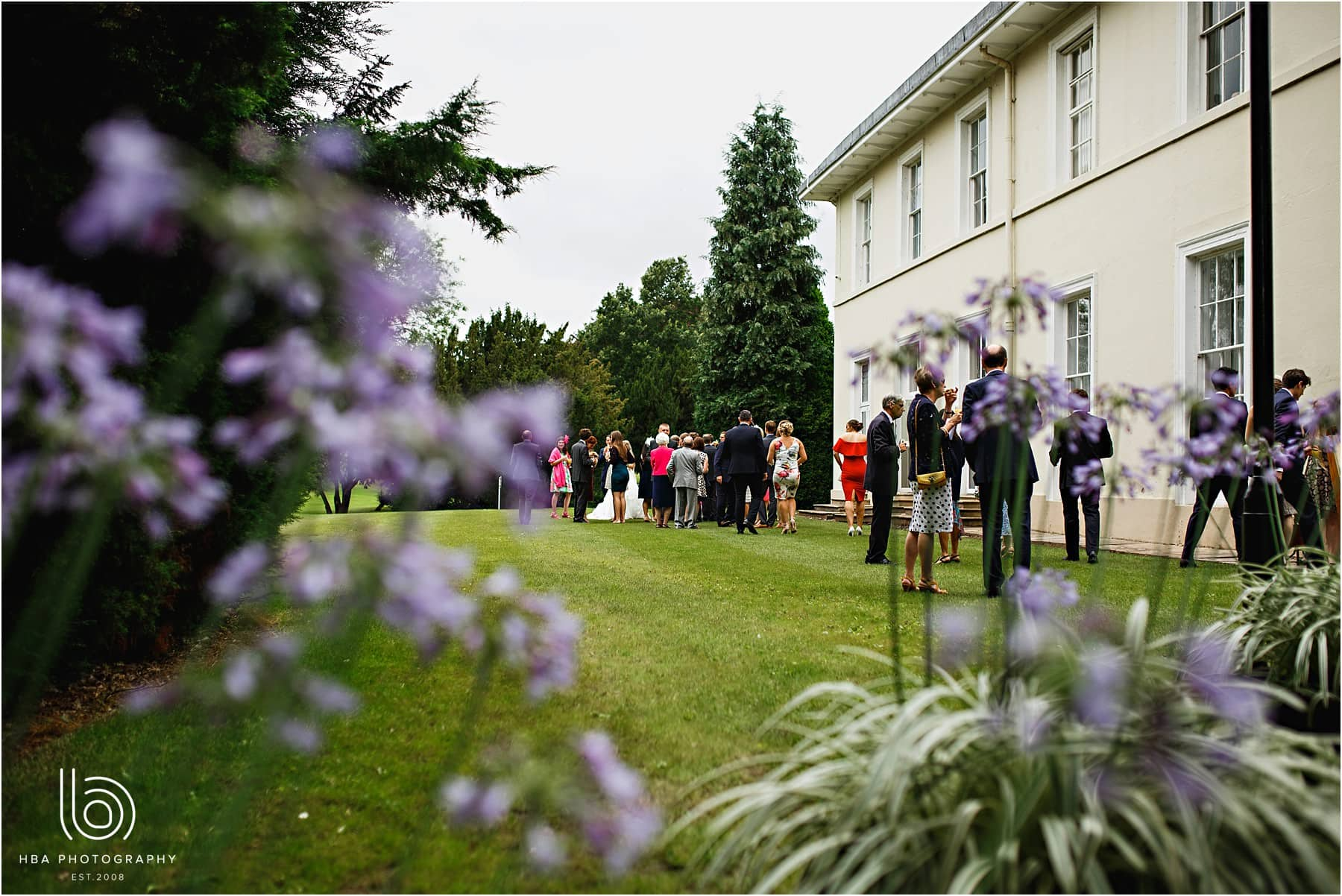 wedding guests in the gardens at Eastwood Hall