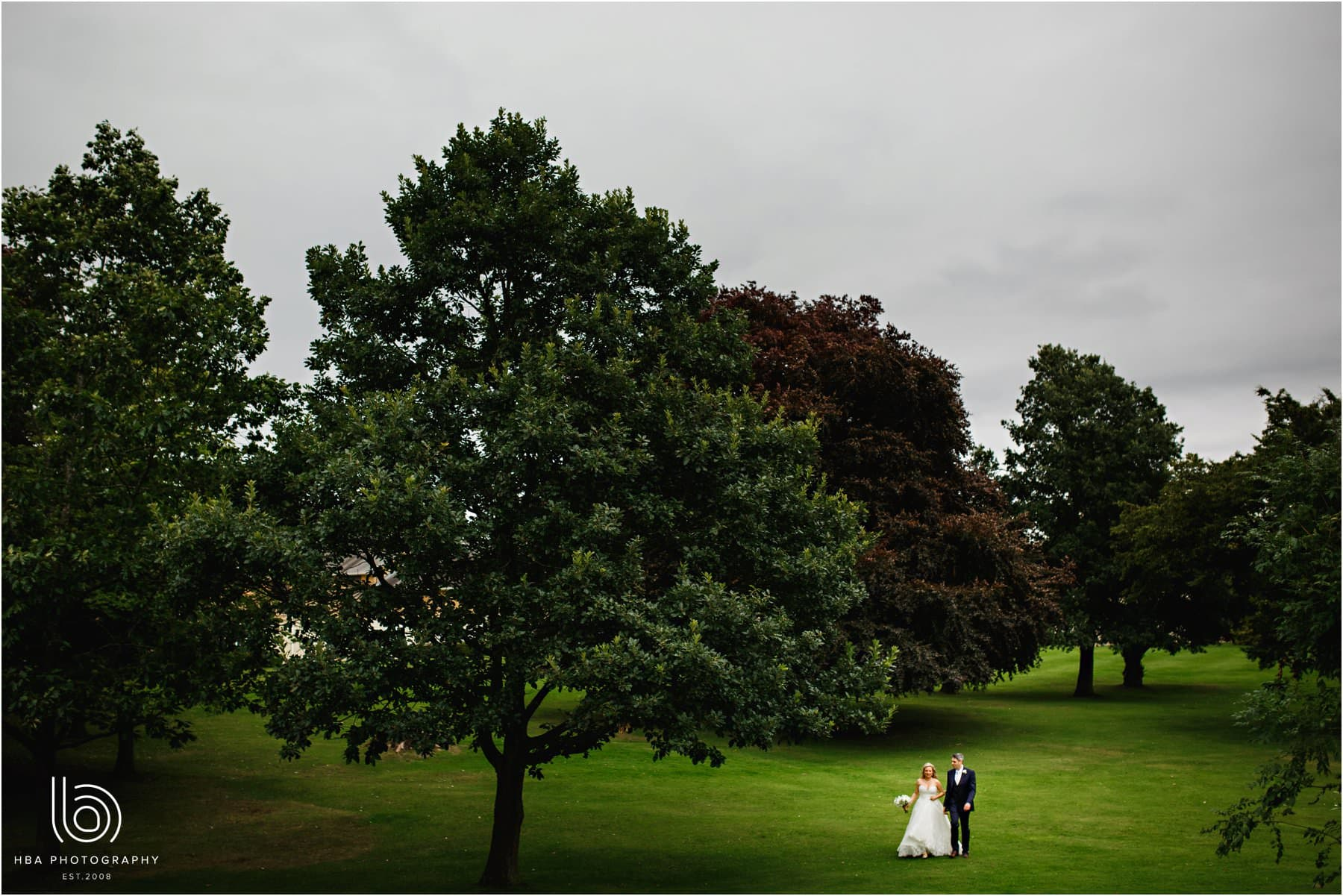 the bride & groom walking at Eastwood Hall