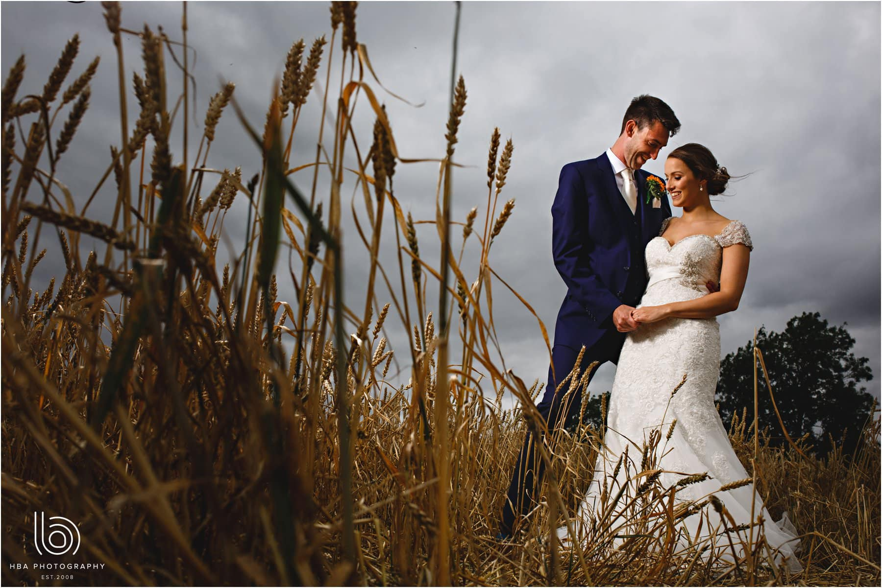 the bride & groom in the cornfield
