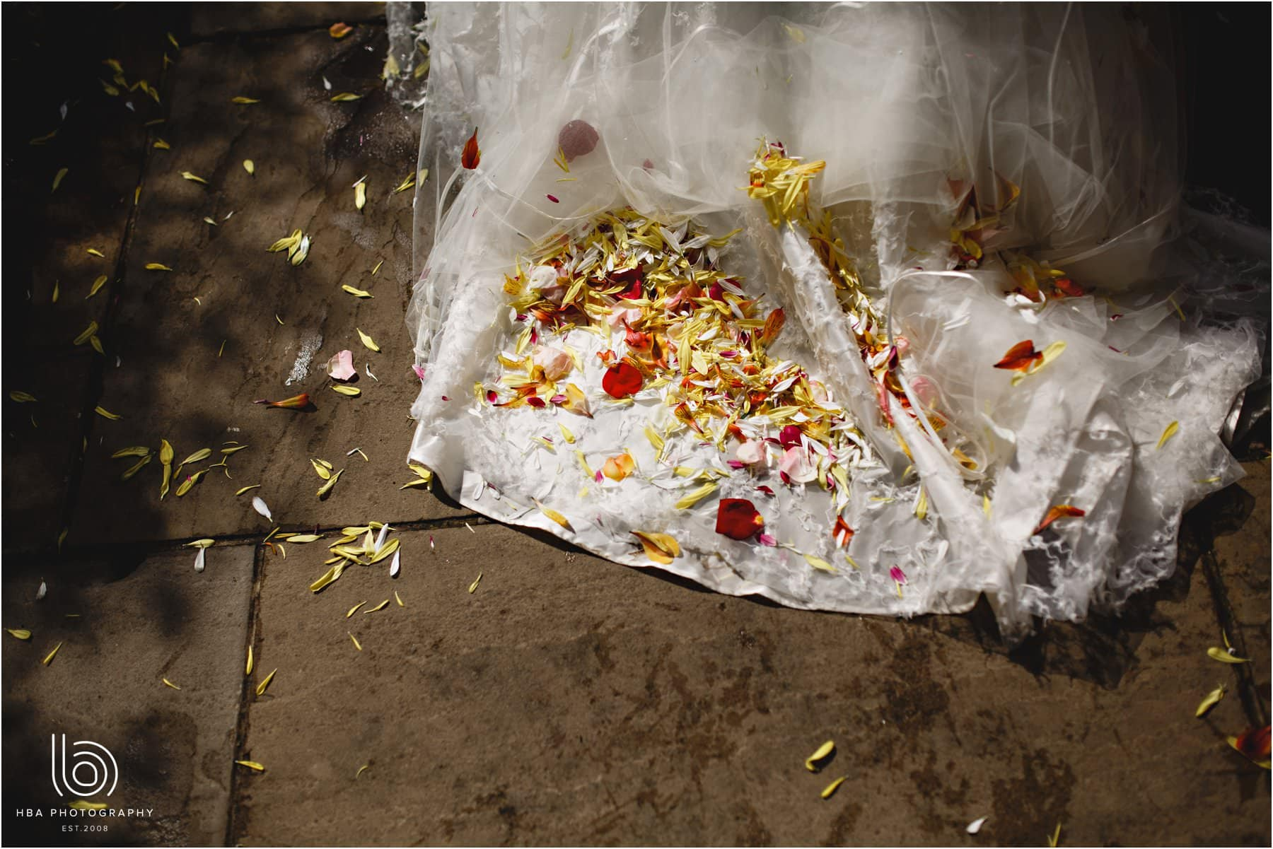 the bride's dress covered in confetti