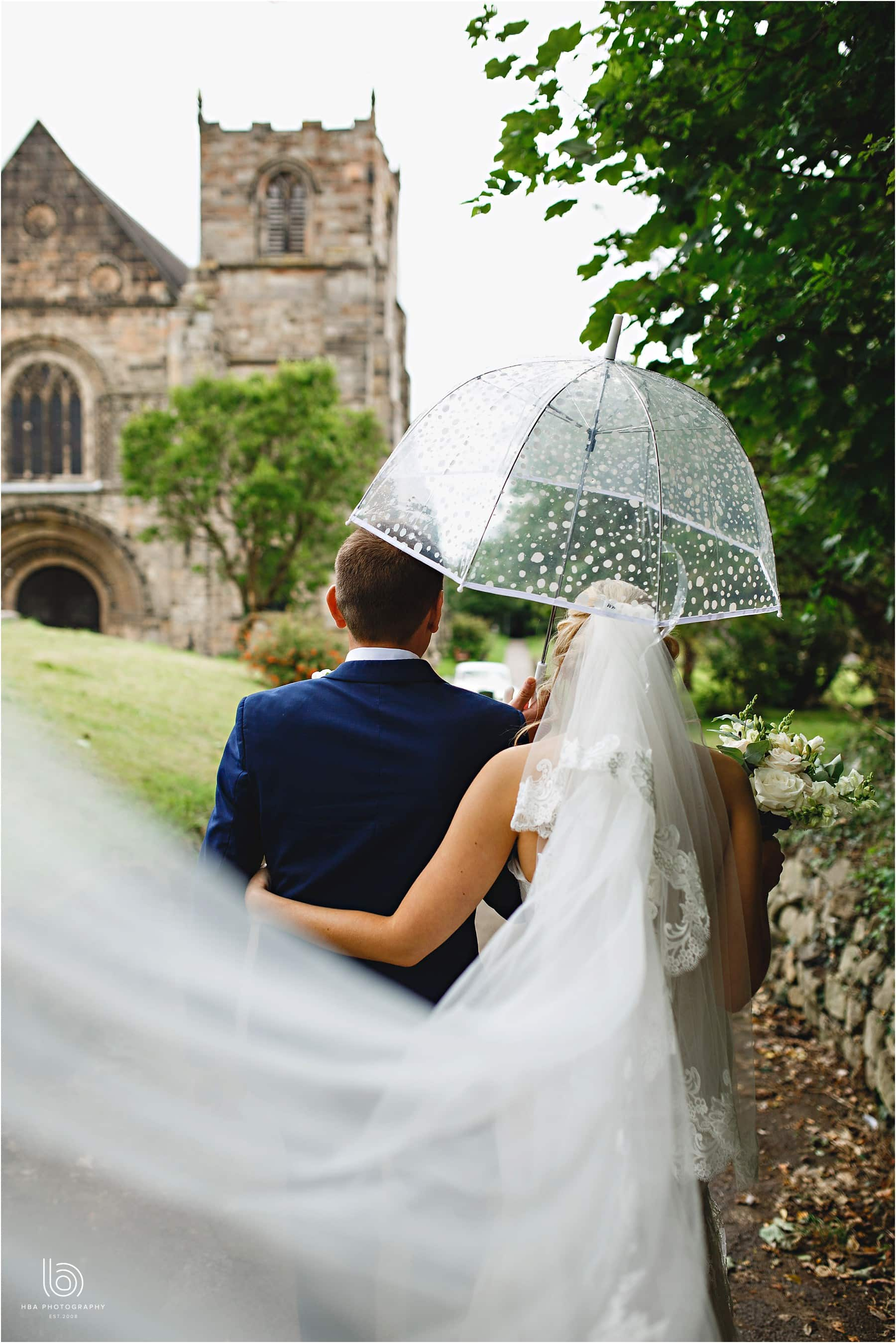 the bride & groom with an umbrella