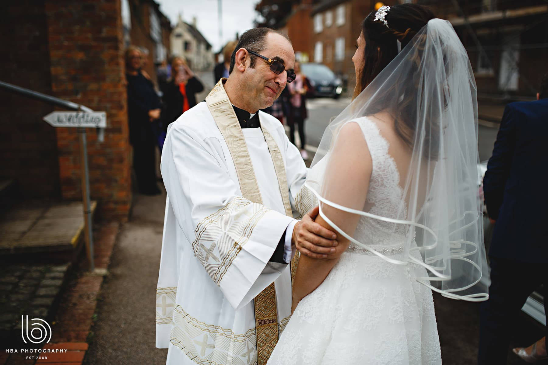 the vicar greeting the bride
