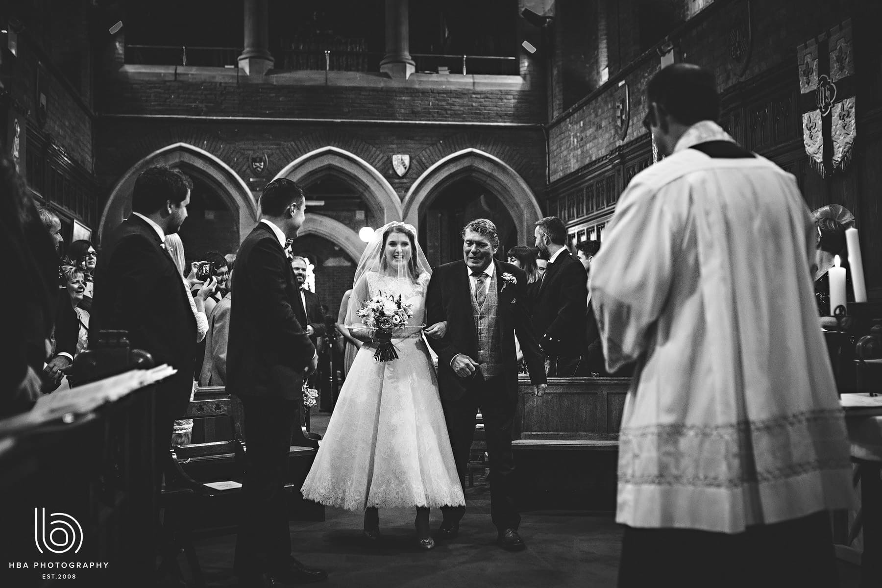 The bride & groom in the chapel at Abbots Bromley school