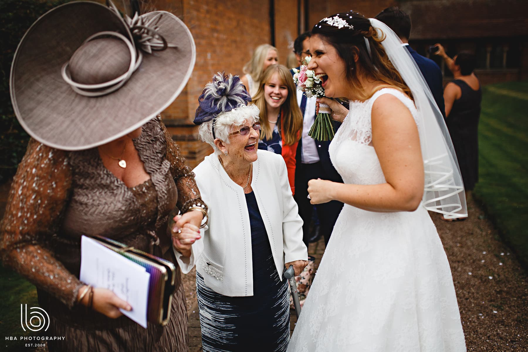 the bride laughing with her grandma
