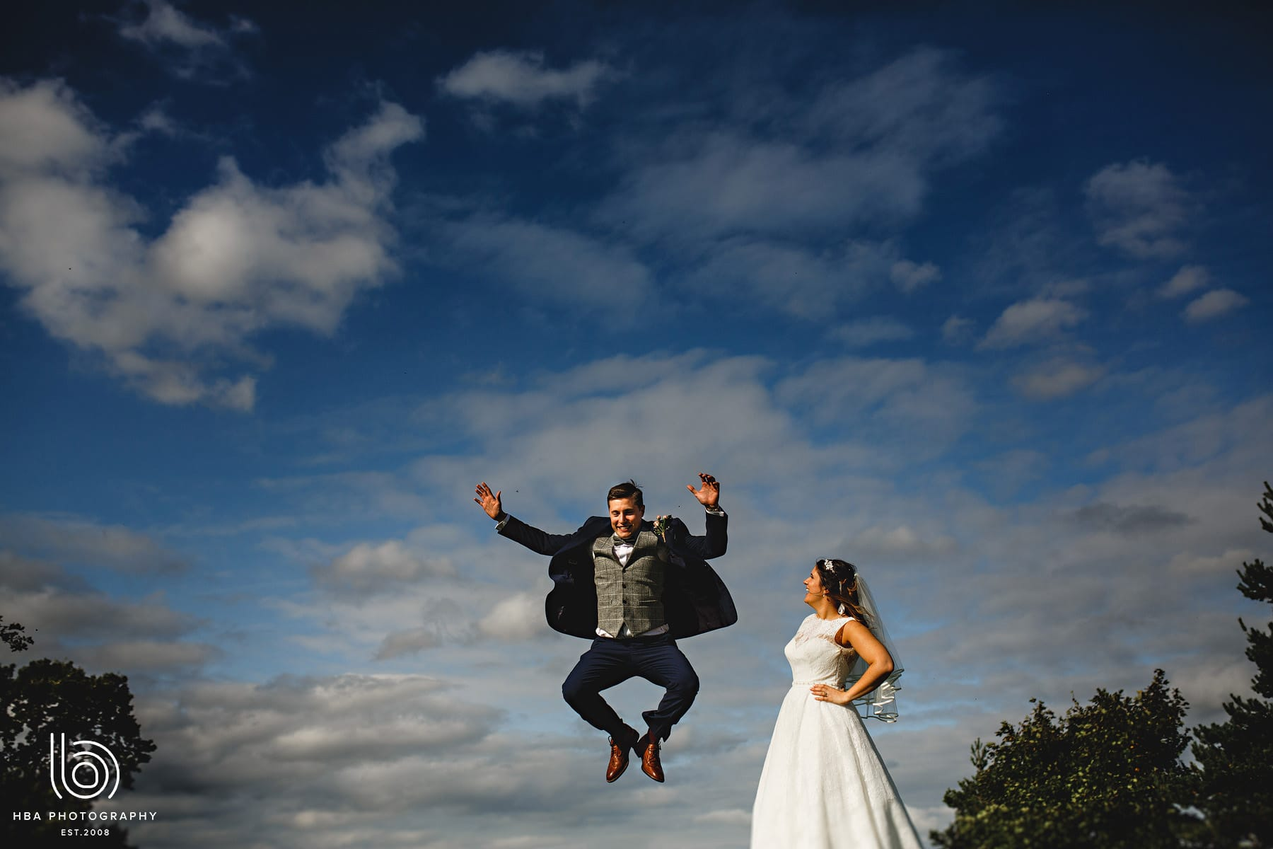 the groom jumping for joy