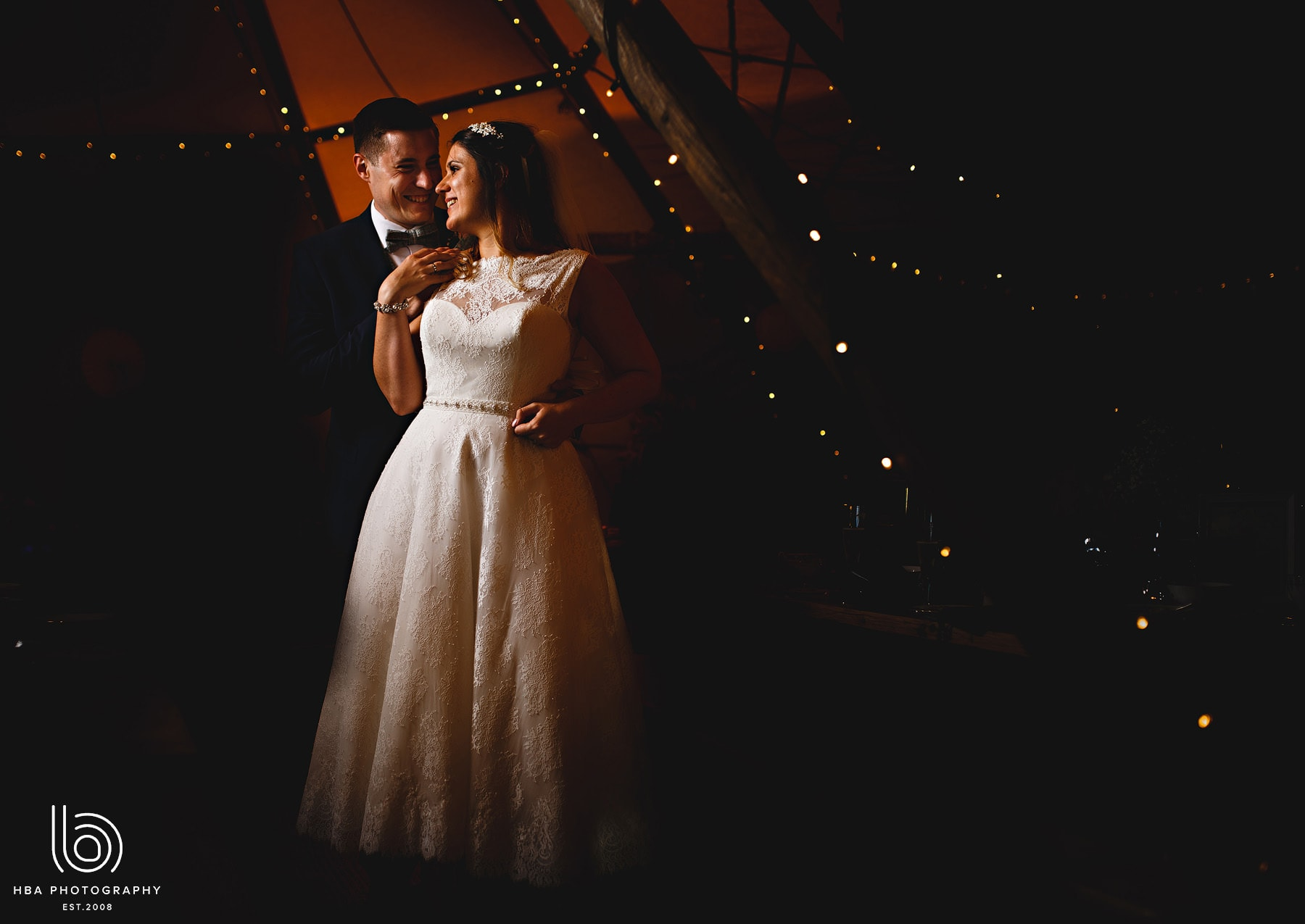 The bride & groom inside the tipi