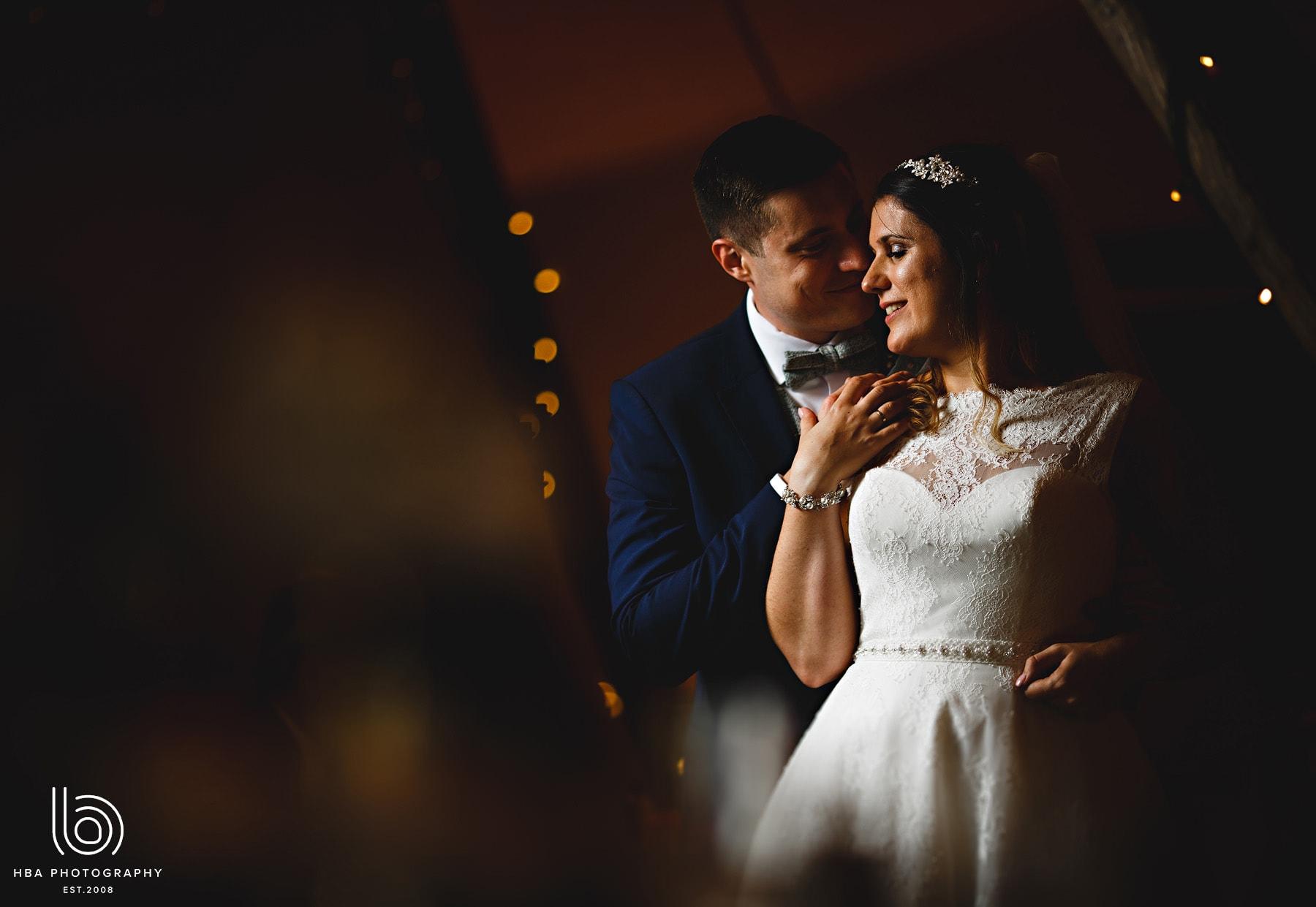 The bride & groom inside the tipi
