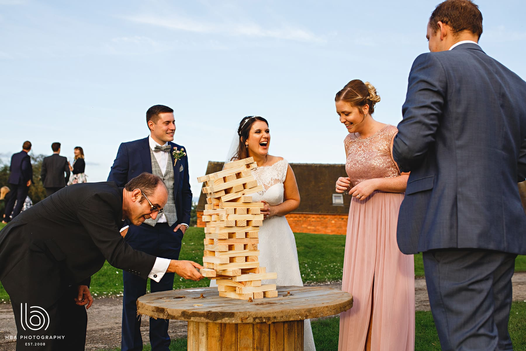 The bride & groom and guests playing games