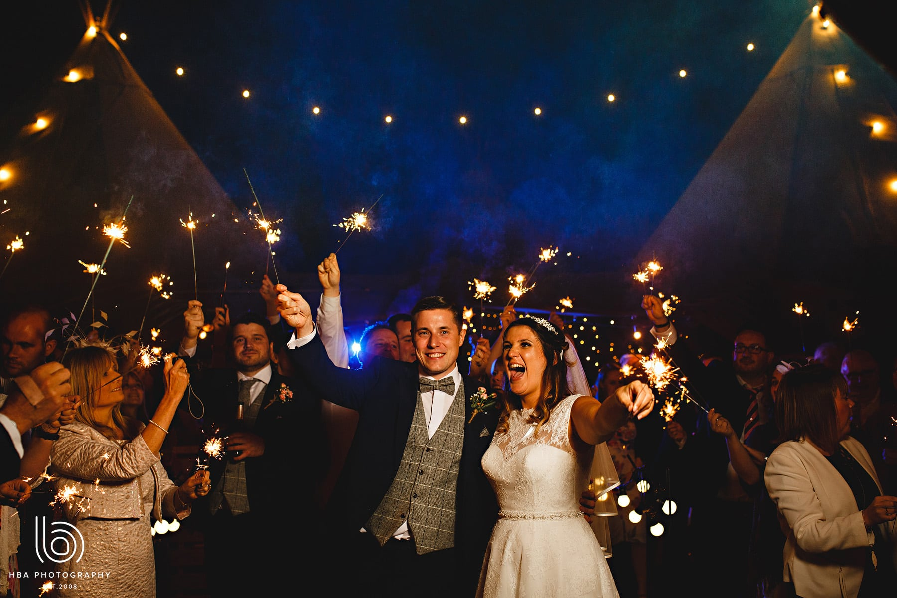 The bride & groom with their sparklers