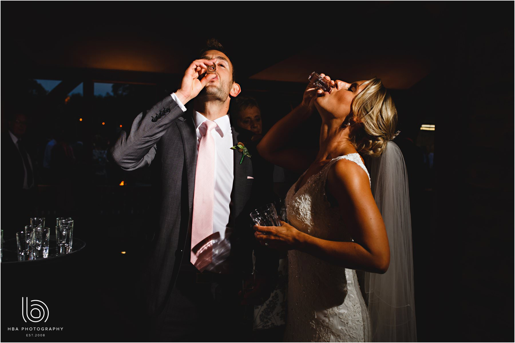 The bride & groom doing shots