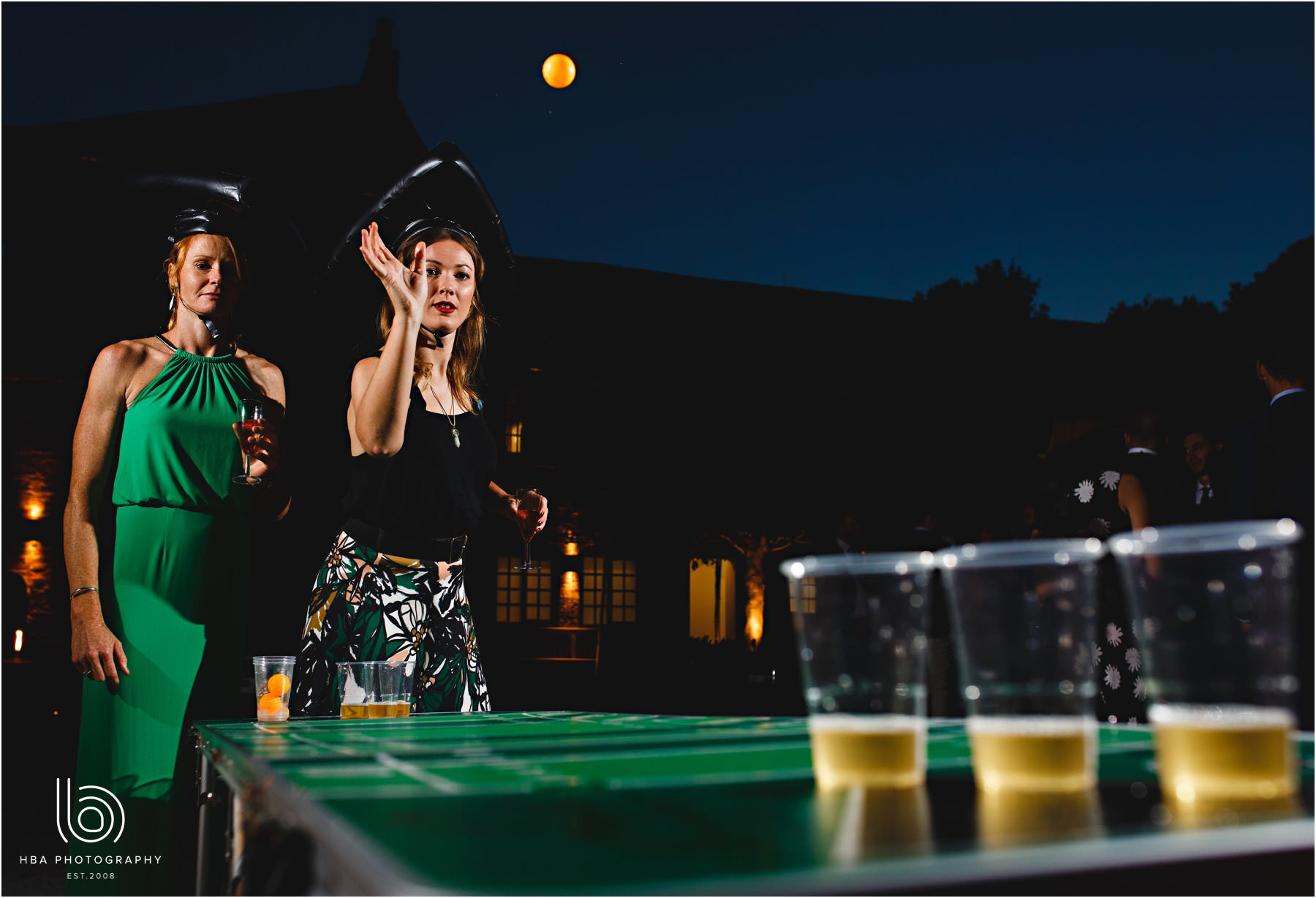guests playing beer pong