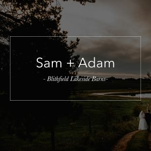 the bride and groom stood in the dark with orange light surrounded b smoke at Hazel Gap Barn