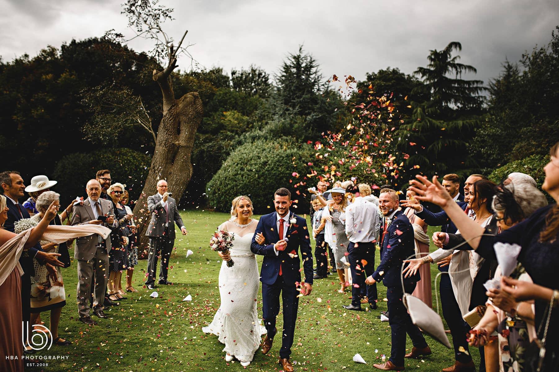 bride & groom getting covered in confetti