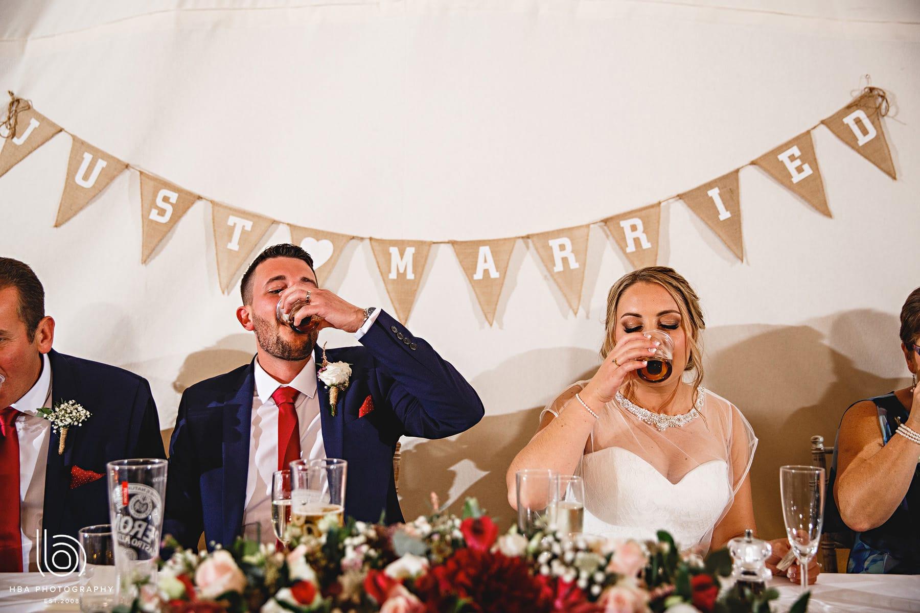 bride & groom doing shots
