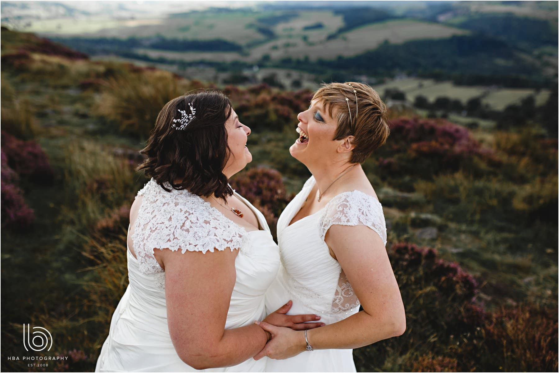the two brides laughing at Curbur Edge