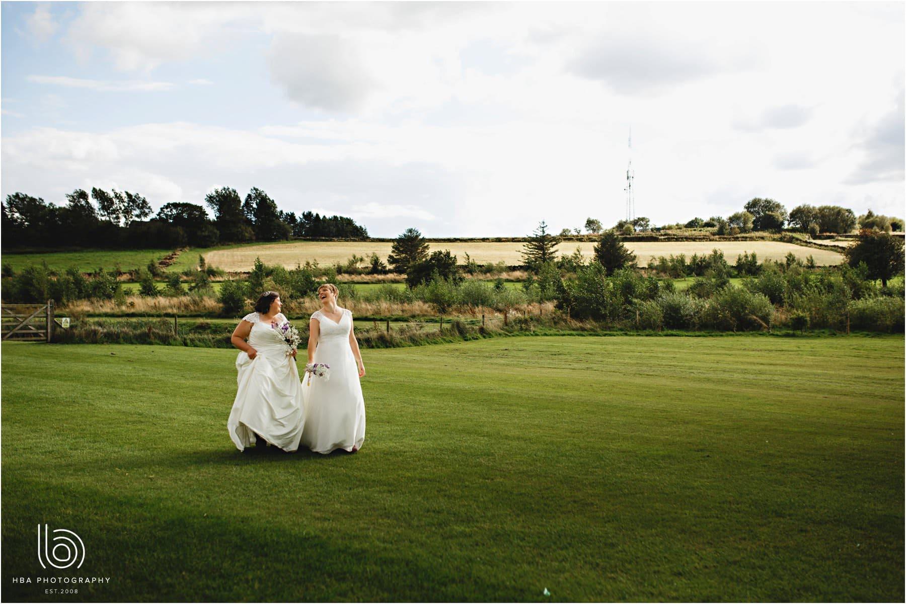 the two brides walking at Peak Edge