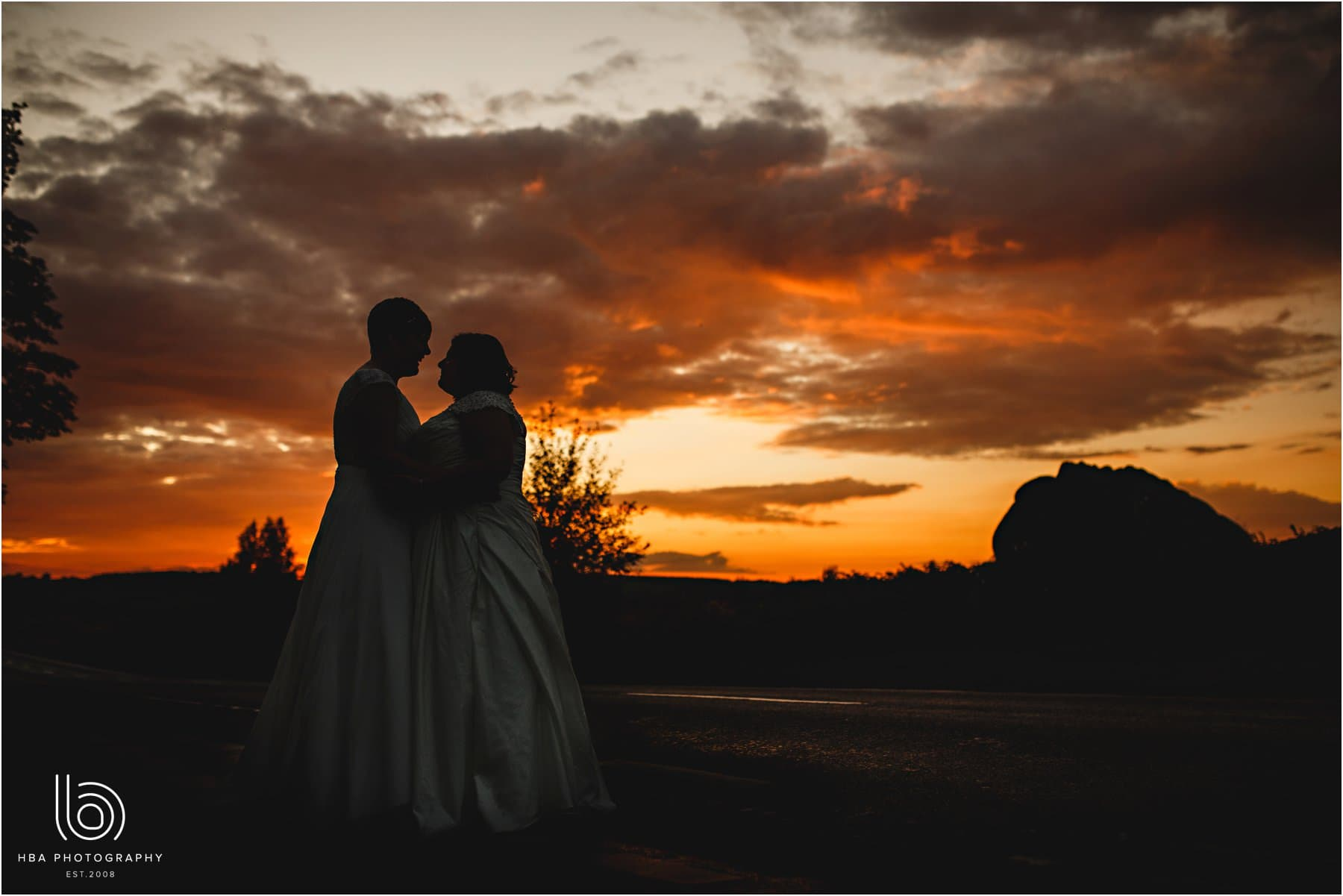 the two brides in the sunset