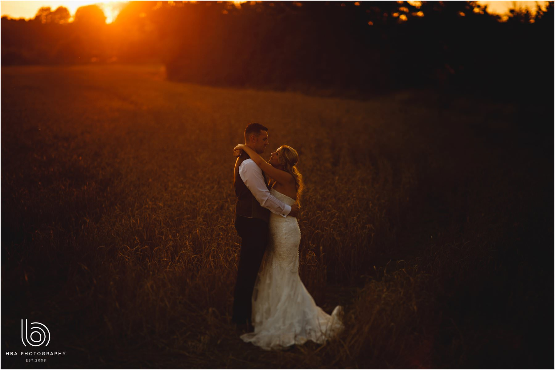 the bride and groom in golden hour sun