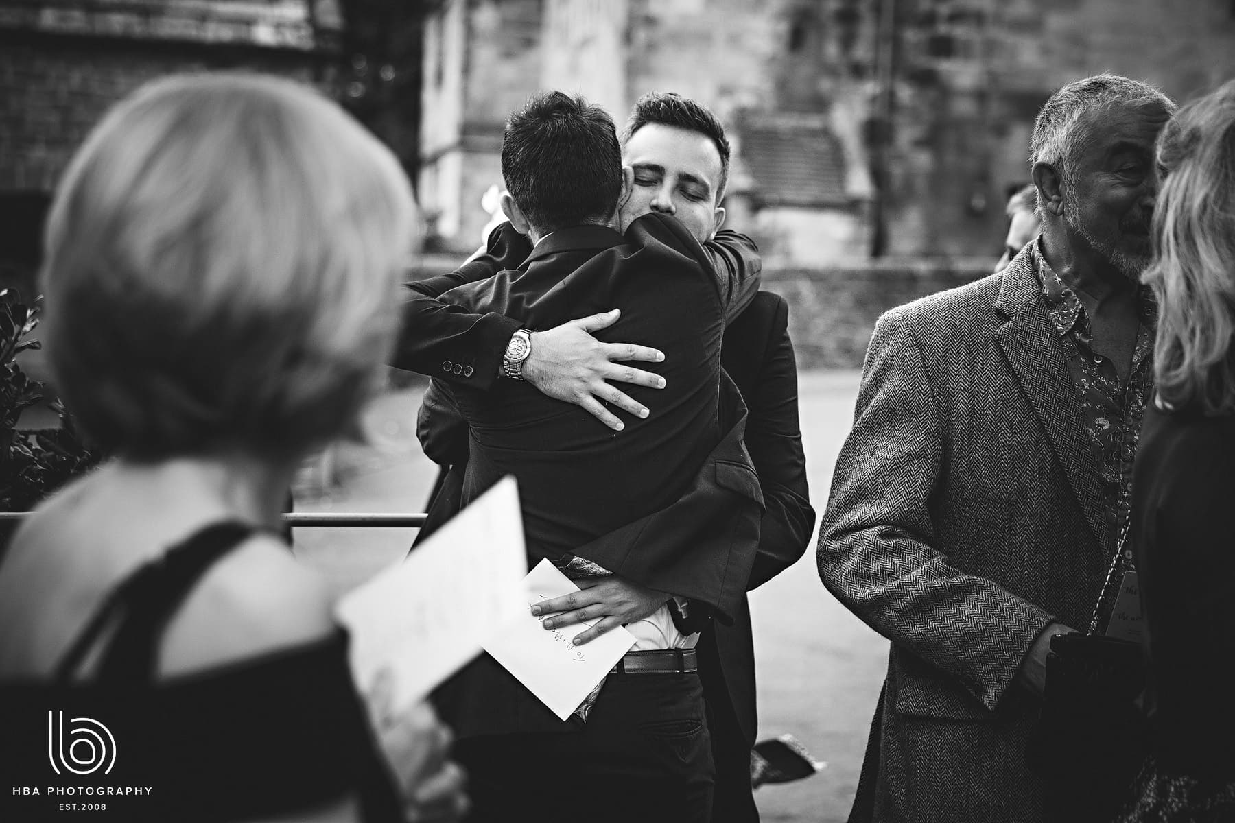 the groom hugging the guests