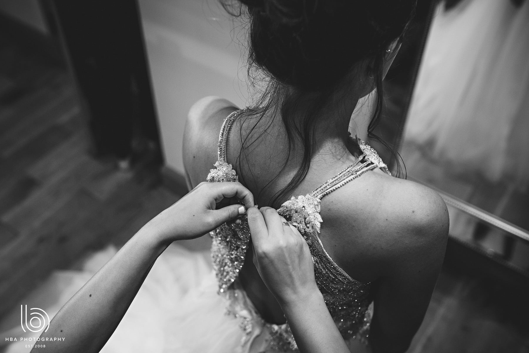 the bride's dress being done up