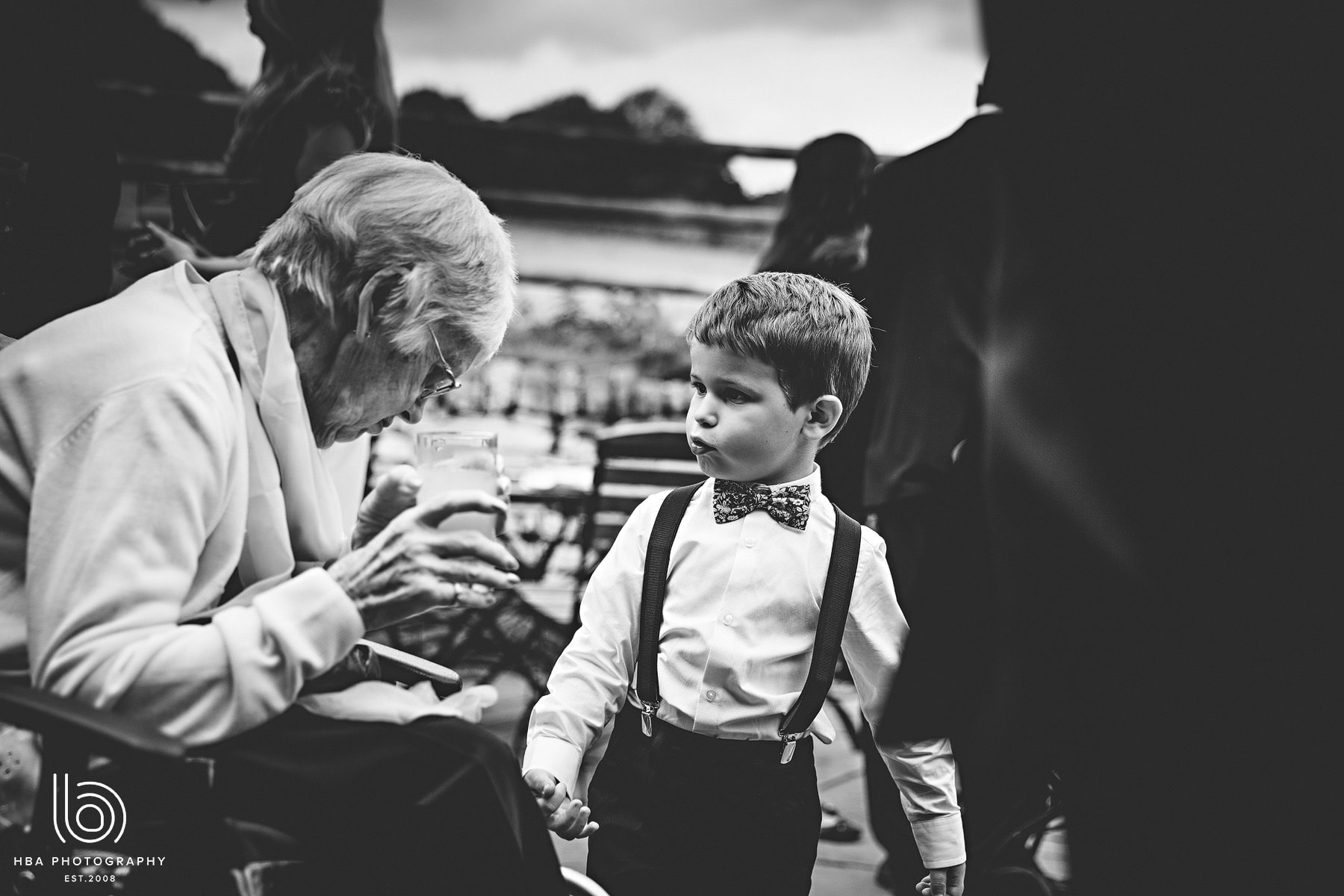 a little boy talking to his grandad