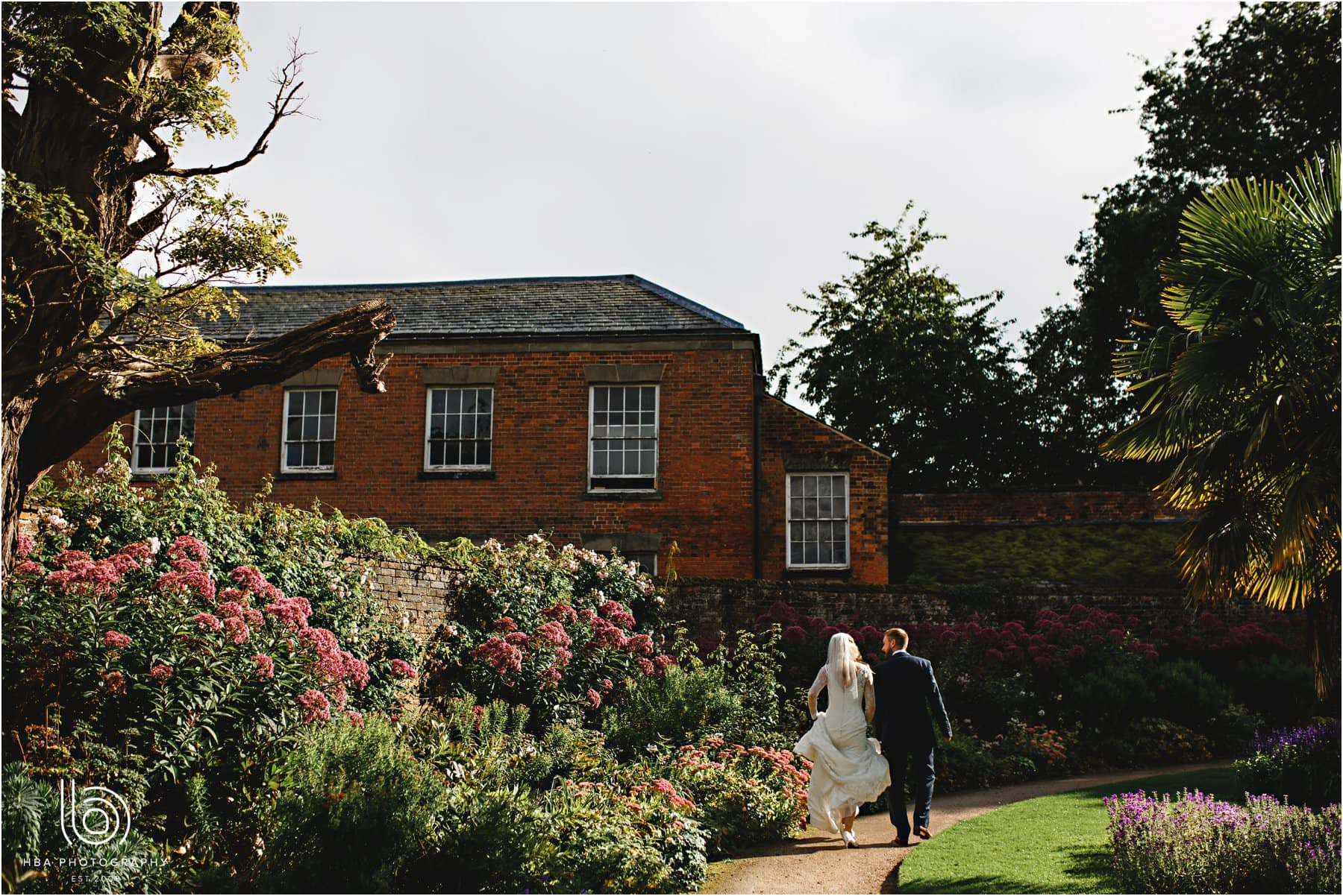 the bride & groom by the gardeners cottage